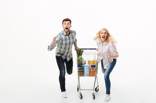 Full length portrait of a shocked couple Free Photo