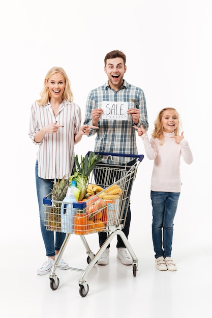 Full length portrait of a surprised family Free Photo