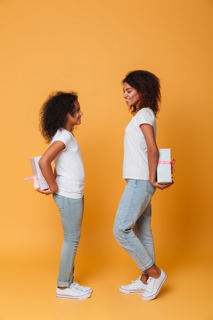 Full length portrait of a two happy afro american sisters Free Photo