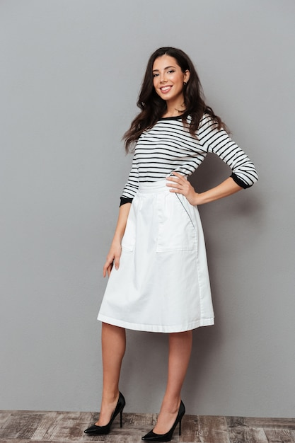 Full length portrait of a woman dressed in a skirt Free Photo