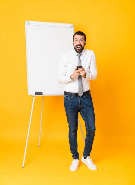 Full-length shot of businessman giving a presentation on white board Premium Photo