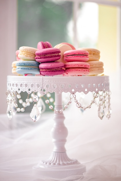 Full-length  of white plate with  marshmallow, macarons. elegant and luxurious. Premium Photo