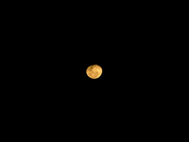 Full moon behind clouds at night Premium Photo