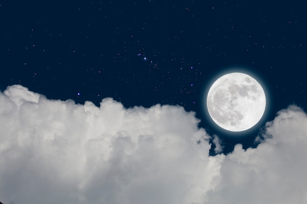 Full moon with starry and clouds background. romantic night. Premium Photo