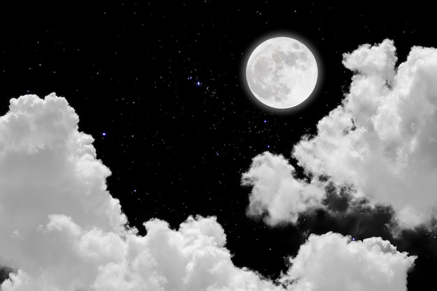 Full moon with starry and clouds background Premium Photo
