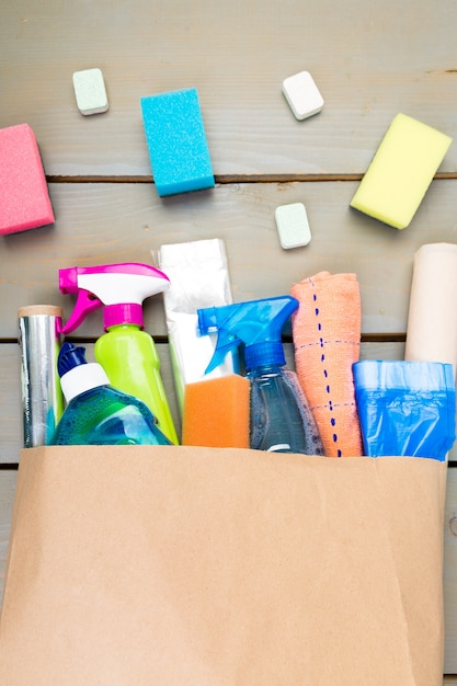 Full paper bag of different house cleaning product, Premium Photo
