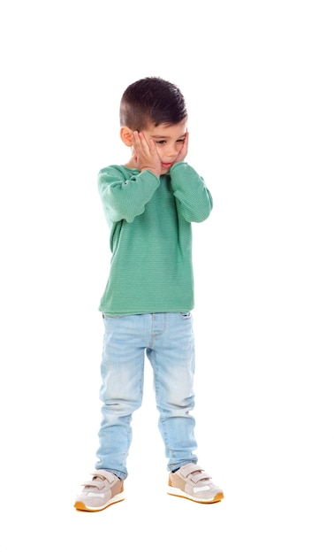 Full portrait of surprised child with jeans and green t-shirt Premium Photo