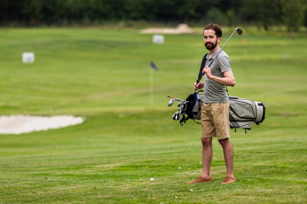 Full shot adult man at the golf course Free Photo