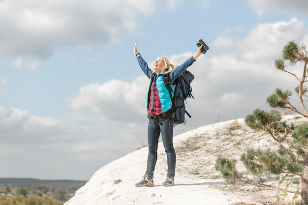 Full shot adult woman enjoying the nature Free Photo