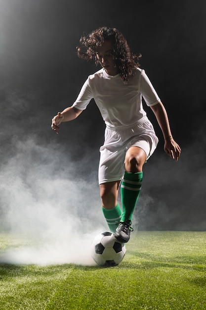 Full shot adult woman with soccer ball Free Photo