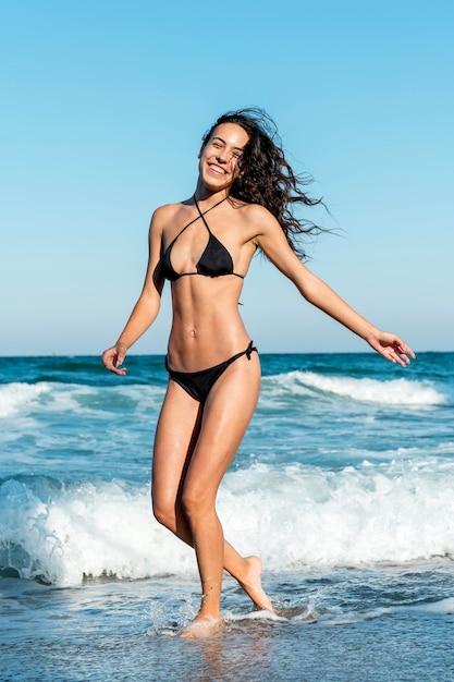 Full shot of beautiful girl at beach Free Photo