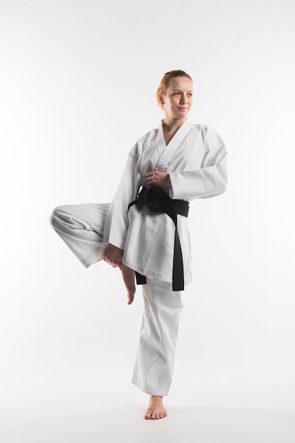 Full shot of female karate fighter Free Photo