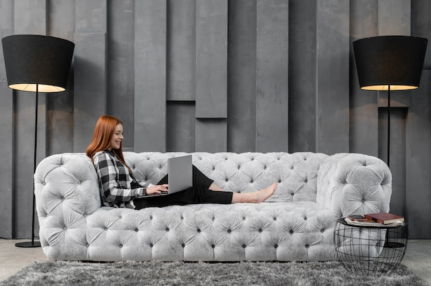 Full shot female relaxing on couch Premium Photo