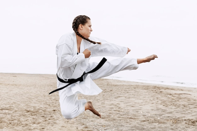 Full shot fit girl karate training Free Photo
