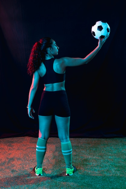 Full shot fit young girl with soccer ball Free Photo