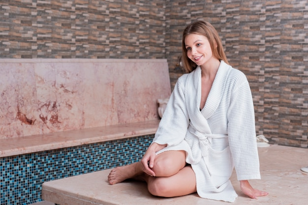 Full shot girl with robe and wide smile Free Photo