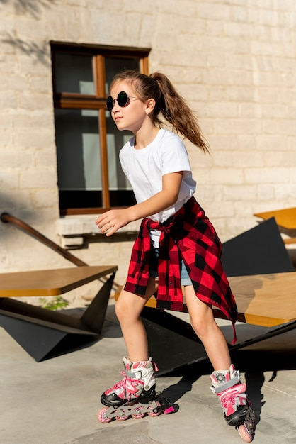 Full shot of girl with roller blades Free Photo