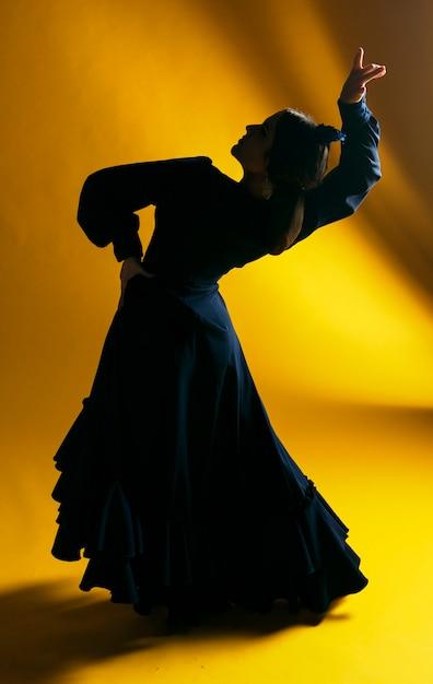 Full shot gorgeous dancer bending back Free Photo