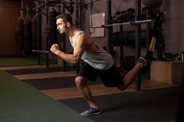 Full shot man training at gym Free Photo