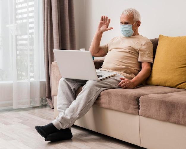 Full shot man wearing mask indoors Premium Photo