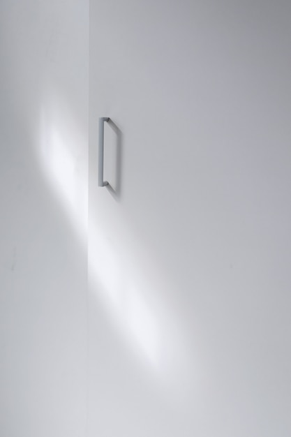 Full shot metallic handle on cupboard Free Photo