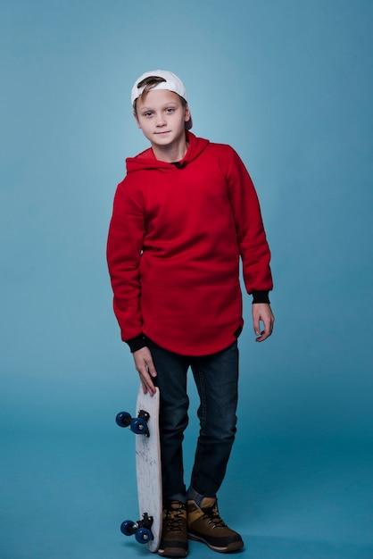 Full shot of modern boy with skateboard Free Photo