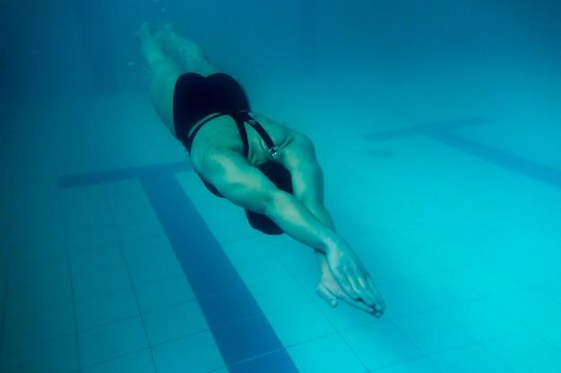 Full shot olympic swimmer underwater Free Photo