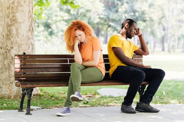 Full shot of upset interracial couple Free Photo