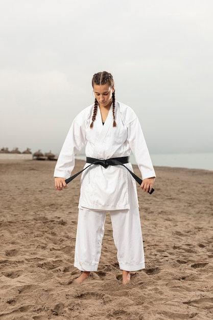 Full shot woman in martial arts outfit Free Photo
