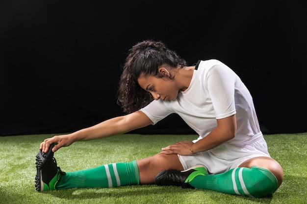 Full shot woman in sportswear stretching Free Photo