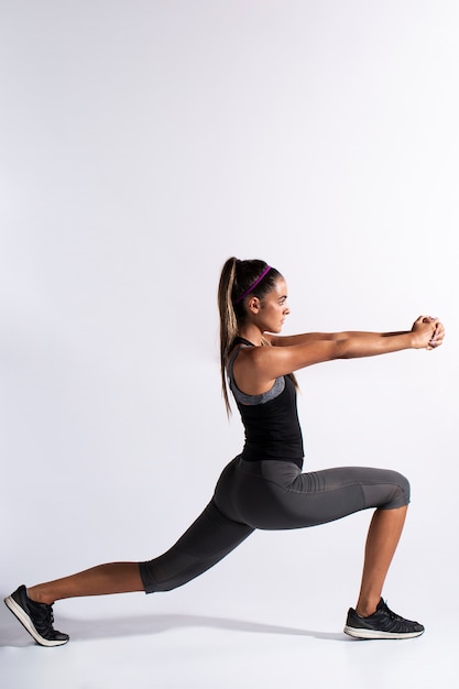 Full shot woman stretching with copy-space Free Photo