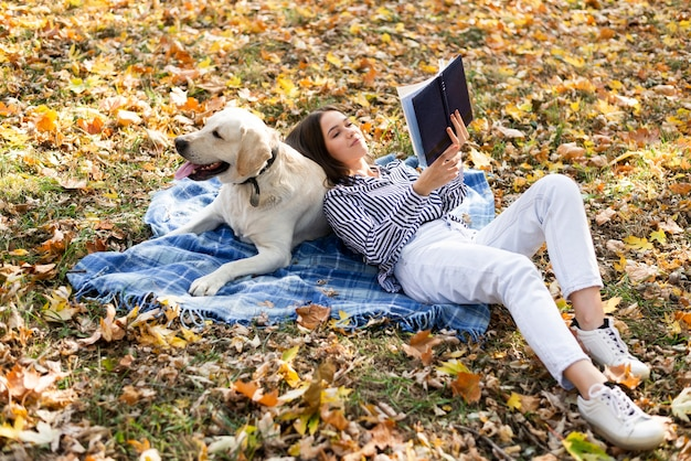 Full shot woman with cute dog Free Photo