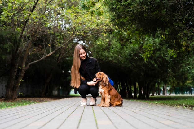 Full shot young woman with her dog Free Photo