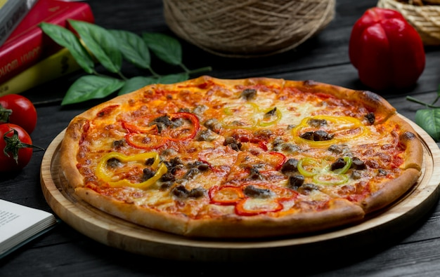 Full tomato sauce pizza with black olive rolls Free Photo