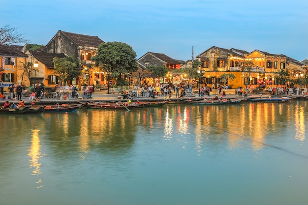 Full of tourists walking on street in hoi an ancient town at dusk Premium Photo