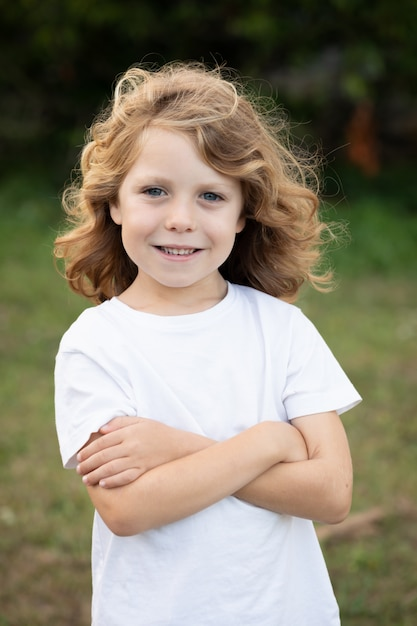 Funny blond kid with long hair Premium Photo