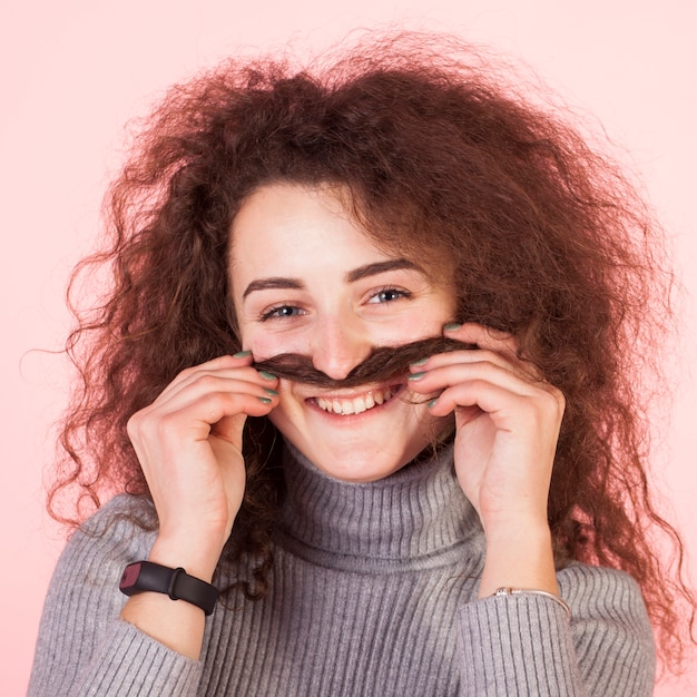 Funny brunette girl portrait on pink background Free Photo