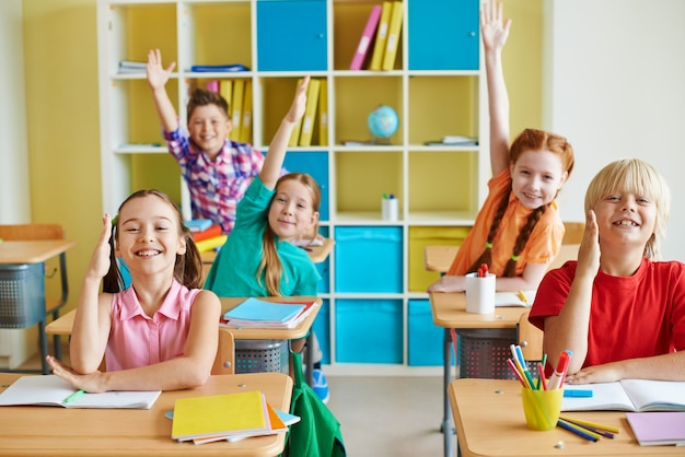 Funny children in a classroom Free Photo