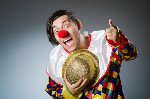 Funny clown on dark Premium Photo