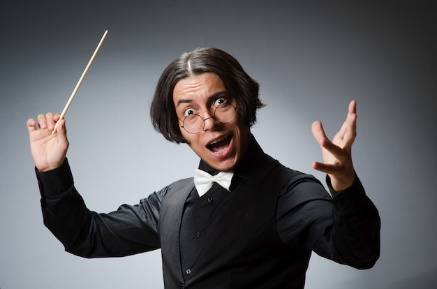 Funny conductor in musical concept Premium Photo