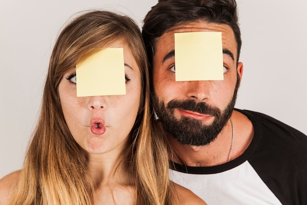 Funny couple with post its on head Free Photo