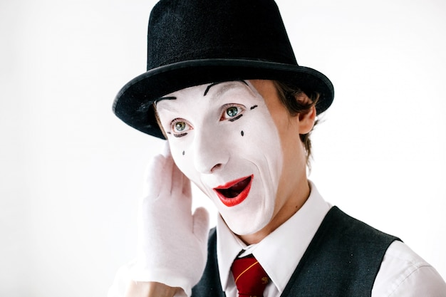 Funny curious mime hears something Free Photo