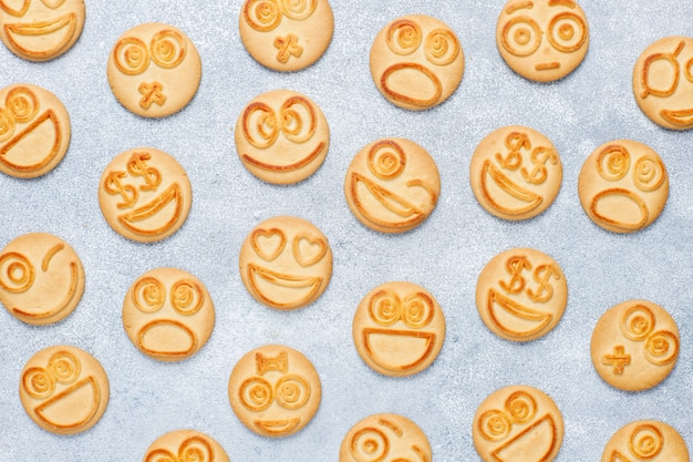 Funny different emotion cookies ,smiling and sad cookies Free Photo