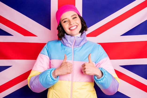 Funny exchange student lady making abroad photos for parents wear warm colored coat isolated pink background Premium Photo