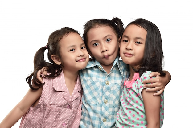 Funny expression asian small kids with her friend Premium Photo
