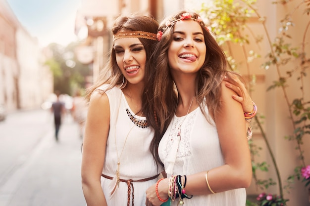 Funny faces of hippie female friends Free Photo