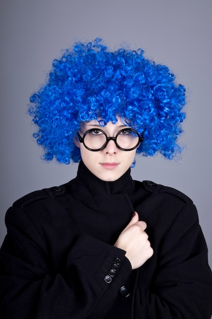 Funny fashion blue-hair girl in glasses and black coat. Premium Photo