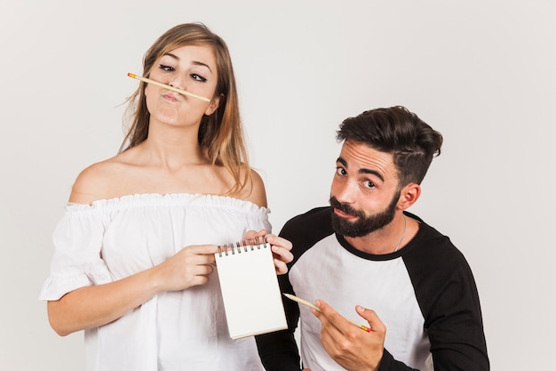 Funny friends holding notepad Free Photo