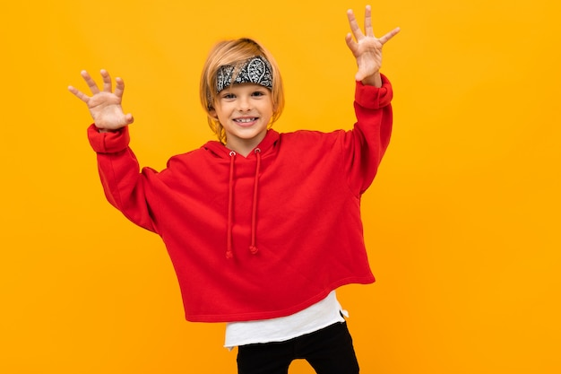 Funny funny guy in red clothes on a yellow background smiling Premium Photo