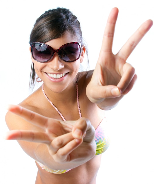 Funny girl gesturing peace with two hands Free Photo